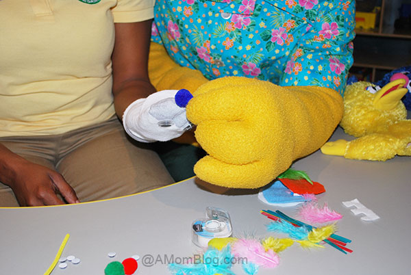 Bert helping make a puppet at camp sesame